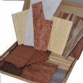 Box of various real wood veneer offcuts.